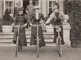 Three women on bicycles, early 1900s (b/w photo)