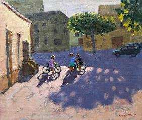 Three children with bicycles, Spain