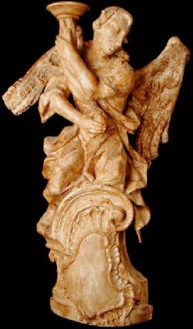 One of a pair of carved angel candlesticks