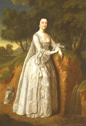 Elizabeth Montague standing in a Wooded Landscape