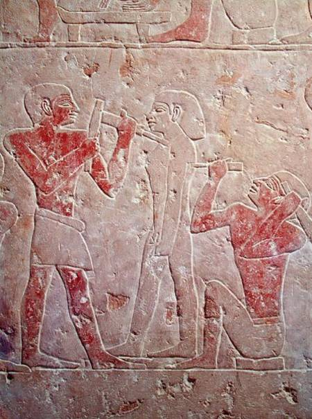 Relief depicting two sculptors carving a egyptian