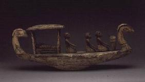 Tomb model of a boat, with a mummy on a bier under a canopy with three male crew, with a mummy on a