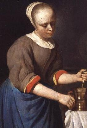 Young girl with a pestle and mortar