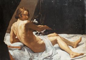 Young Man Lying on a Bed with a Cat