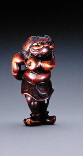 Netsuke of an Oni wearing a tiger-skin loincloth, Edo