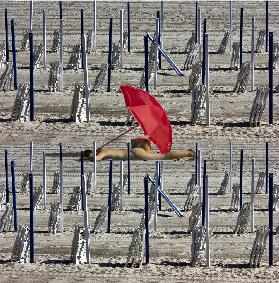 Composition of poles and chairs with red umbrella