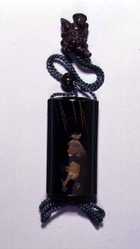 Netsuke and inro case depicting Abura Bozu, the Oil Thief