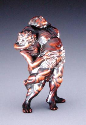 Netsuke depicting a deity wrestling a demon