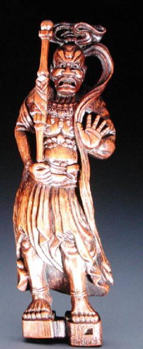 Netsuke depicting a temple guardian sculpture