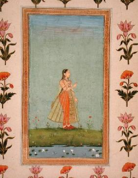 Lady holding a flower, standing by a lily pond, from the Small Clive Album