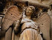 Detail of one of St. Nicaise's angels, Sculpture from exterior west facade, 14th century (stone) (se