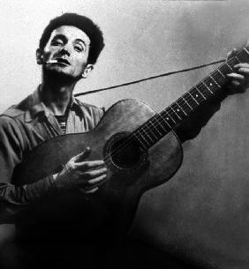 Musician Woody Guthrie con...