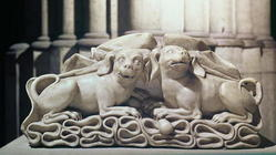 Two dogs seated on folds of a tomb, 12th century (marble)