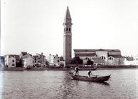 View of the church of San Martino on the island of Burano from the lagoon (b/w photo)