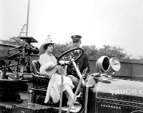 Woman driving a firefighter truck