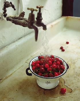 Washing cherries, 1988 (colour photo)