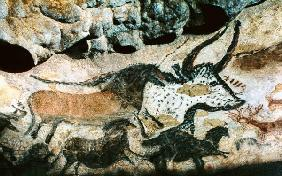 Rock painting of a bull and horses